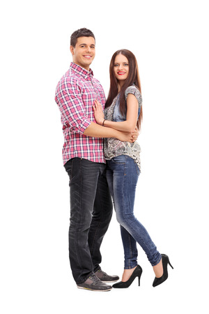 love expression: Full length portrait of a young couple hugging and posing isolated on white background Stock Photo
