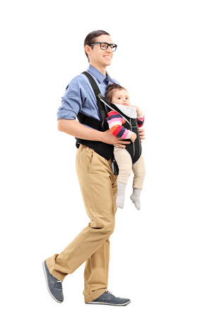 carrying girl: Full length portrait of a young father with his daughter walking isolated on white background Stock Photo