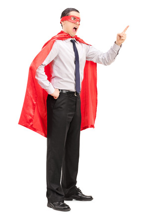 Full length portrait of an angry superhero gesturing with his finger isolated on white background photo