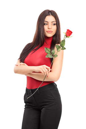 Vertical shot of an attractive woman holding a red rose isolated on white background photo