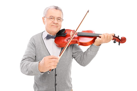 playing music: Cheerful mature man playing a violin isolated on white background