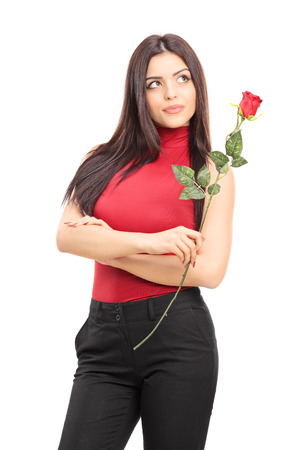 imagining: Beautiful pensive woman holding a red rose isolated on white background