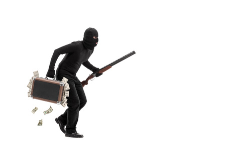 stealing money: Criminal with briefcase full of stolen money running away quietly isolated on white background