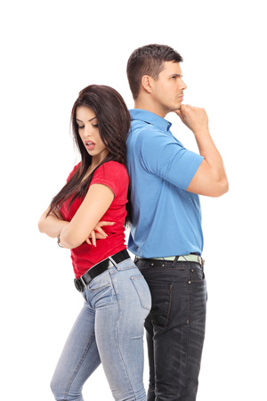 conflicted: Vertical shot of a conflicted couple not talking to each other isolated on white background