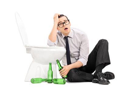 waster: Drunk guy leaning on a toilet seat isolated on white background