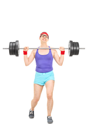 attempting: Full length portrait of a nerdy athlete attempting to lift a weight isolated on white background Stock Photo