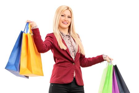Elegant woman holding shopping bags isolated on white background photo