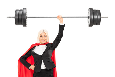 Female superhero lifting a barbell isolated on white background Stock Photo