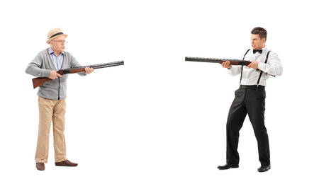 shootout: Mature man and a young guy having a shootout with shotguns isolated on white background