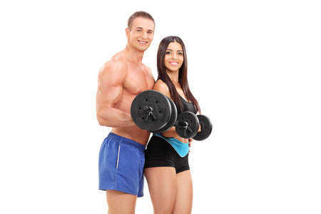 Couple of young athletes exercising with barbells isolated on white background photo