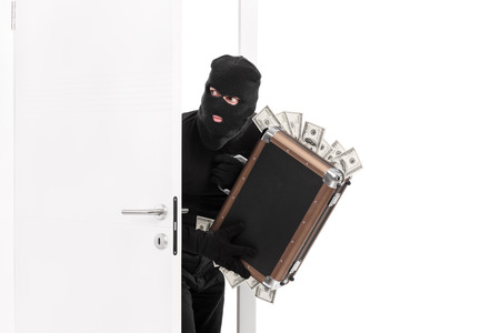 the entering: Thief with a bag full of money entering a room isolated on white background