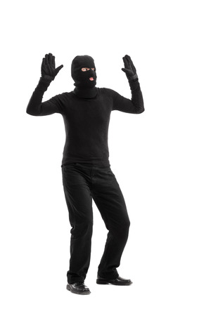 surrender: Full length portrait of a thief surrendering to someone isolated on white background