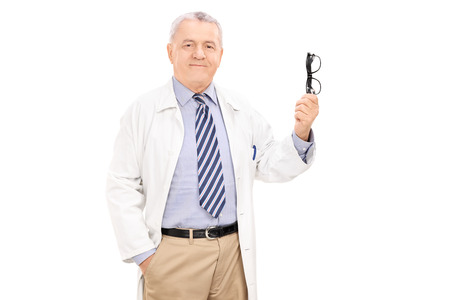 Mature doctor holding a pair of glasses isolated on white background photo