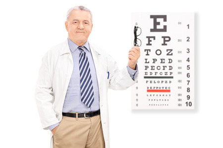 Optometrist holding glasses in front of eye chart isolated on white background photo