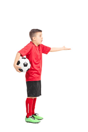 displeasure: Full length portrait of a junior football player gesturing displeasure isolated on white background