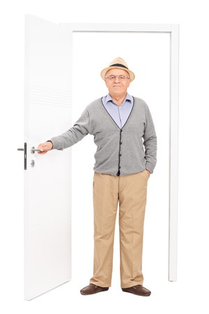 causal: Full length portrait of a senior entering a room isolated on white background