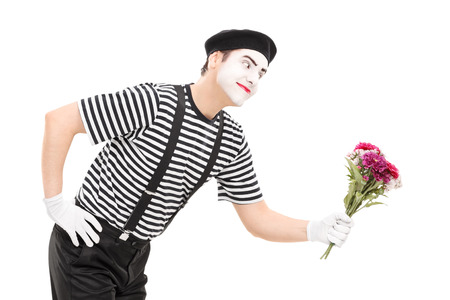artist: Mime artist giving flowers to someone isolated on white background Stock Photo