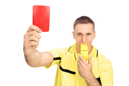 ref: Referee showing red card and blowing huge whistle isolated on white background