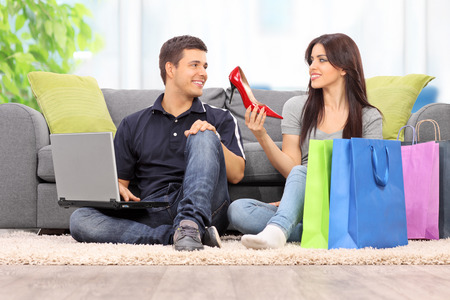 home shopping: Woman showing her new shoes to boyfriend at home
