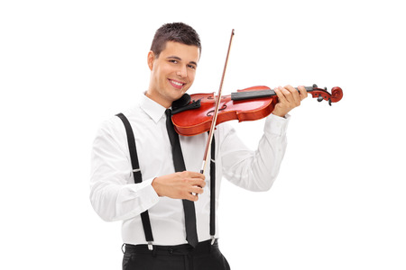 violin background: Young smiling elegant man playing a violin and looking at camera isolated on white background