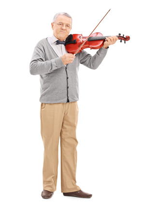 violin background: Full length portrait of a senior musician playing a violin with a wand isolated on white background