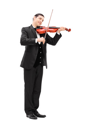 young musician: Full length portrait of a elegant musician playing an acoustic violin isolated on white background