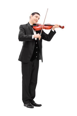 musician: Retrato de cuerpo entero de un elegante m�sico tocando un viol�n ac�stico aislado sobre fondo blanco
