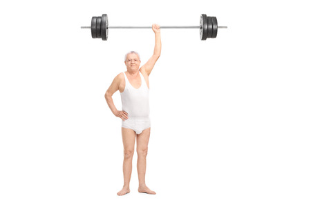 man underwear: Full length portrait of a semi-dressed senior lifting a heavy barbell with one hand and looking at the camera isolated on white background