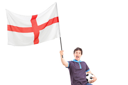 Euphoric young football fan holding an English flag and football isolated on white background Stock Photo