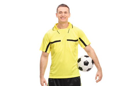 ref: Male football referee in a yellow jersey holding a ball and looking at camera isolated on white background Stock Photo