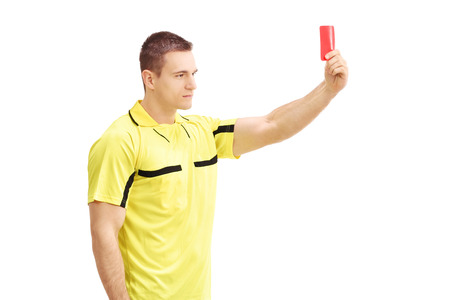 ref: Young football referee in yellow dress showing a red card isolated on white background