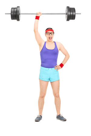 nerdy: Full length portrait of a strong nerdy athlete holding a heavy weight in one hand isolated on white background Stock Photo