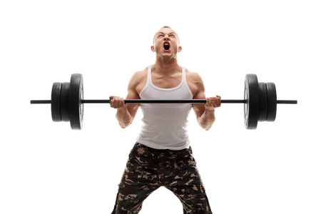 heavy weight: Determined young bodybuilder lifting a heavy barbell and screaming isolated on white background Stock Photo
