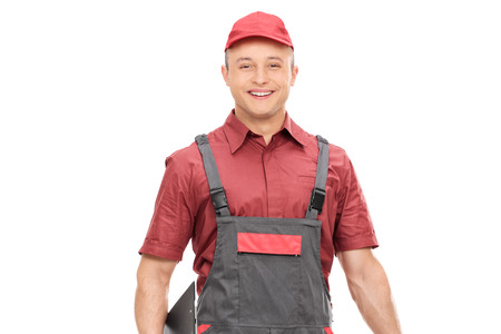 jumpsuit: Young joyful mechanic in a gray jumpsuit isolated on white background