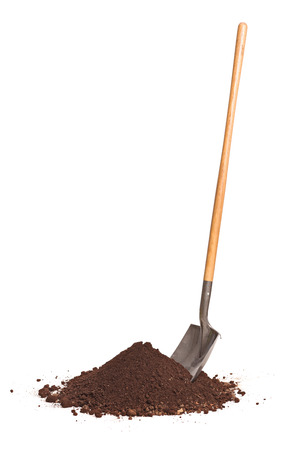 Vertical studio shot of a shovel stuck in a pile of dirt isolated on white background 스톡 콘텐츠