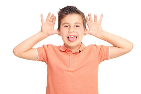 spoiled: Little male kid making a face and sticking his tongue out isolated on white background