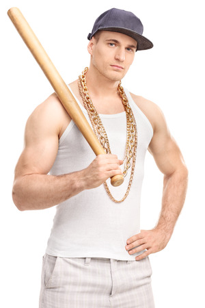 gangster background: Vertical shot of a gangster with a gold chain around his neck holding a baseball bat and looking at the camera isolated on white background Stock Photo