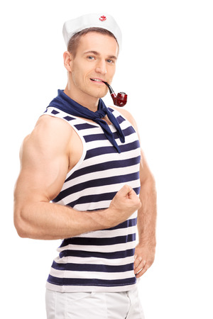 Vertical shot of a male sailor with a pipe in his mouth showing his bicep and looking at the camera isolated on white background Imagens - 39760229