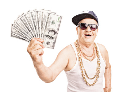 rnb: Toothless old man in hip-hop outfit holding a pile of cash isolated on white background