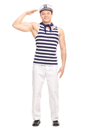 saluting: Full length portrait of a young male sailor standing straight and saluting towards the camera isolated on white background Stock Photo