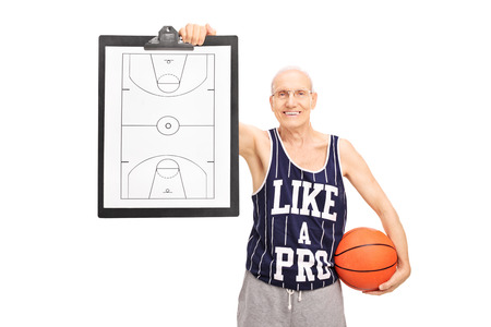 Senior basketball coach showing a clipboard with a basketball court on it isolated on white background photo
