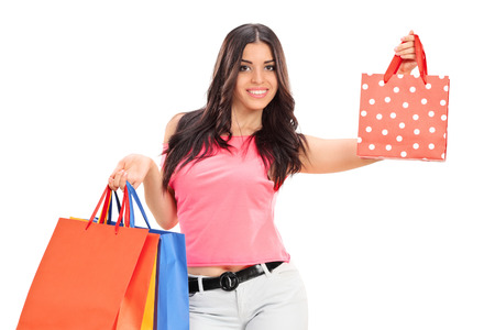 trendy girl: Trendy girl holding shopping bags isolated on white background
