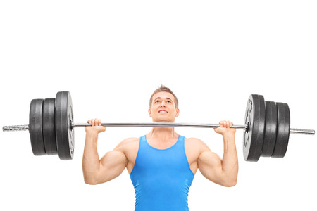 heavy weight: Closeup on a male weightlifting athlete lifting a heavy weight isolated on white background