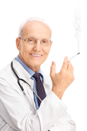 Vertical shot of a mature doctor smoking a cigarette and looking at the camera isolated on white background photo