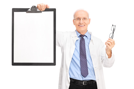Studio shot of a mature optometrist holding a pair of glasses and a clipboard with a blank paper on it isolated on white background photo