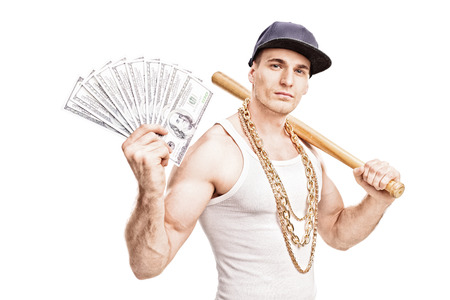 thug: Thug with gold chain around his neck holding a baseball bat and a stack of money isolated on white background Stock Photo
