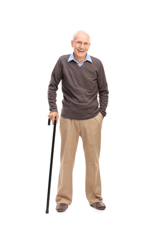 Full length portrait of a senior man with a cane smiling and posing isolated on white background