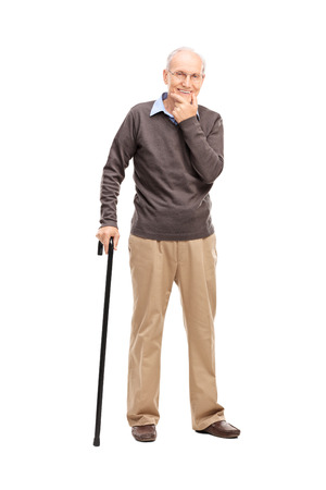 old man happy: Full length portrait of a casual senior with a black wooden cane posing isolated on white background