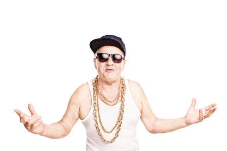 Cocky senior man in a hip-hop outfit gesturing with his hands and looking at the camera isolated on white background Stock Photo