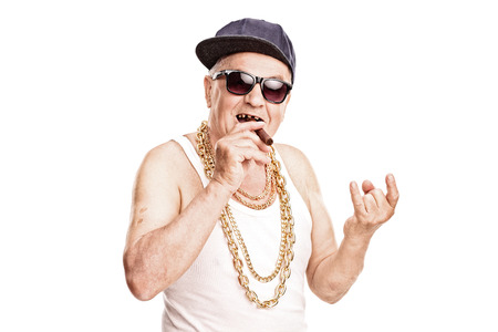 senior smoking: Toothless senior rapper smoking a cigar and making a hardcore sign with his hand isolated on white background